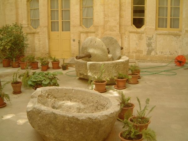 Two Roman grape presses (one complete with grinding stones) at the Mdina Museum