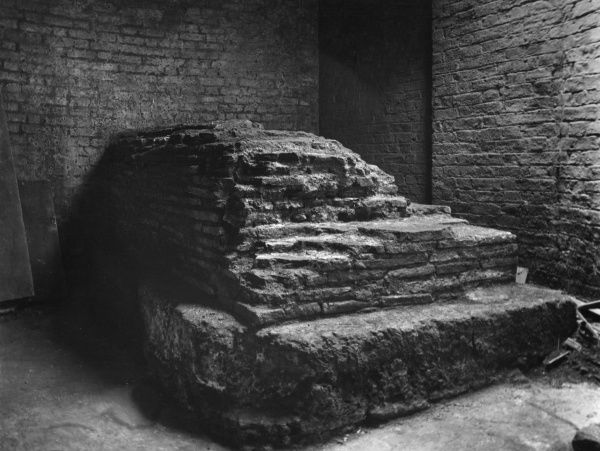 Roman masonry in the basement of business premises on the corner of Gracechurch Street and Leadenhal Market, London. Believed to the be base of a statue and part of the Forum. Date: 1st century