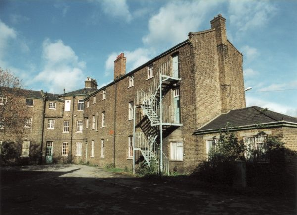 The central cross-shaped block of the Romford Union Workhouse, Essex. The buildings later became part of Oldchurch Hospital. Date: 2000