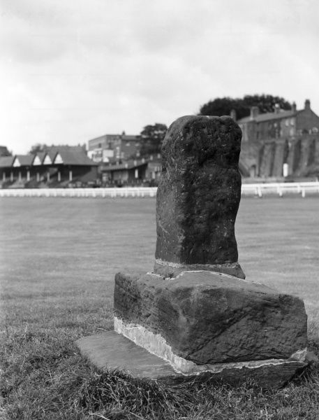 The remains of the ancient cross on Roodee Racecourse, Chester, Cheshire, England, which gets its name from the Saxon 'rood' (cross) and 'eye', meaning 'island'. Date: 1960s
