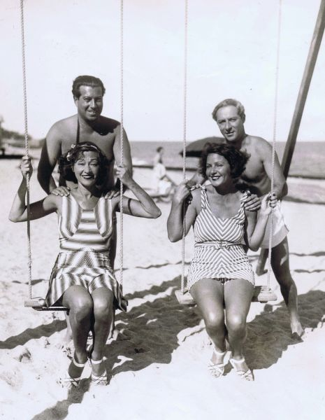 Rosie Dolly (left : Mrs Irving Netcher), Norma Talmadge (right) with Irving Netcher (left) and George Jessel (Norma's fiancee) taken at Palm Beach January 1934. Date: 1934