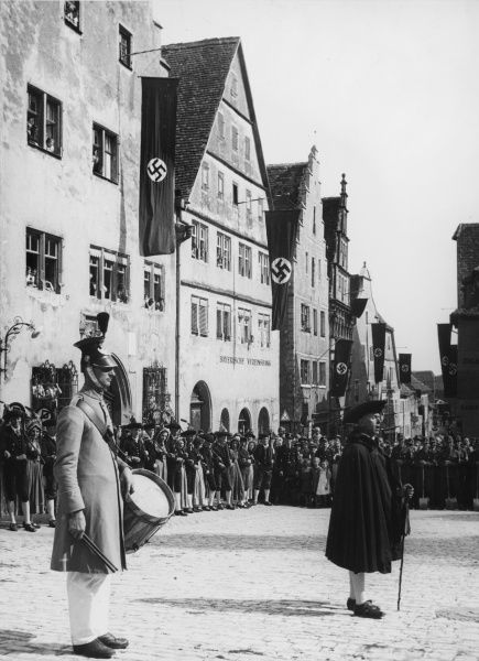 Rothenburg shepherd dance with the leader about to start his dance in Rothenburg, Germany in 1936