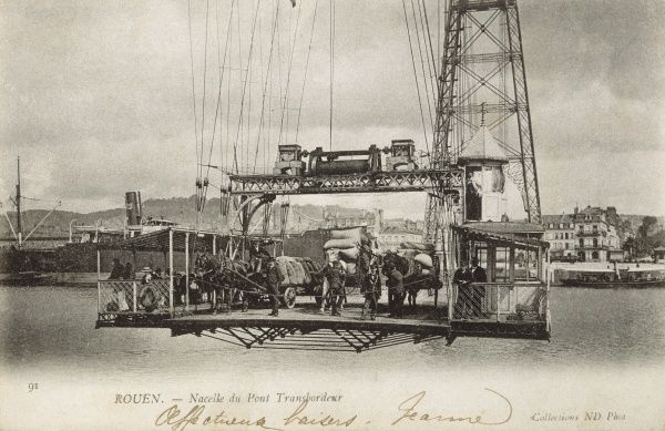 Horse-drawn wagons in the nacelle of le pont transbordeur - transporter bridge across the Seine. Date: 1904