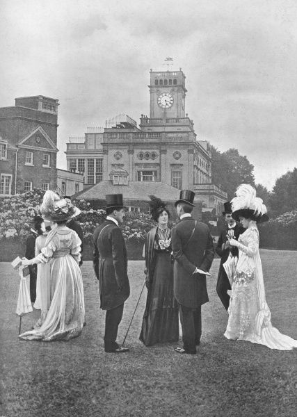A photograph of smartly dressed society on the lawns at Ascot, 1912. The ladies are wearing large feathered hats of the period