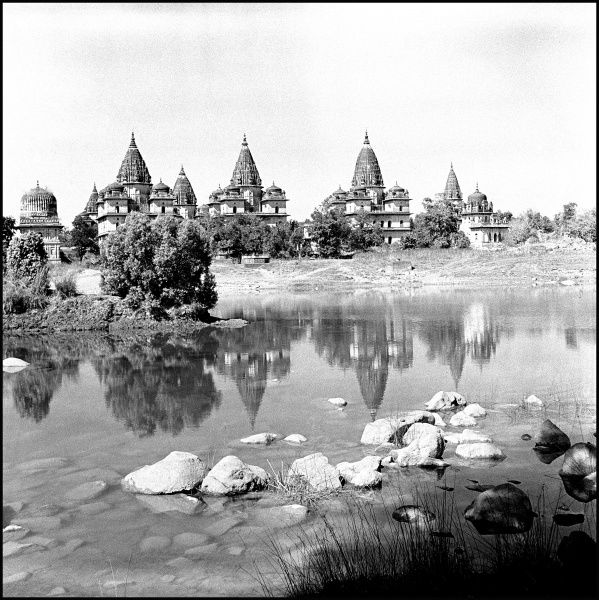 The Royal Chattris (14 cenotaphs or tombs carved out of stone) of former rulers, in Kanchana Ghat on the banks of the river Betwa at Orchha, Madhya Pradesh Province, India. Photograph by Ralph Ponsonby Watts