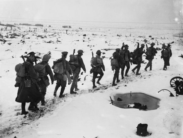 Royal engineers passing across snow-covered ground in single file East of Contalmaison in France on the British front during World War I in February 1917