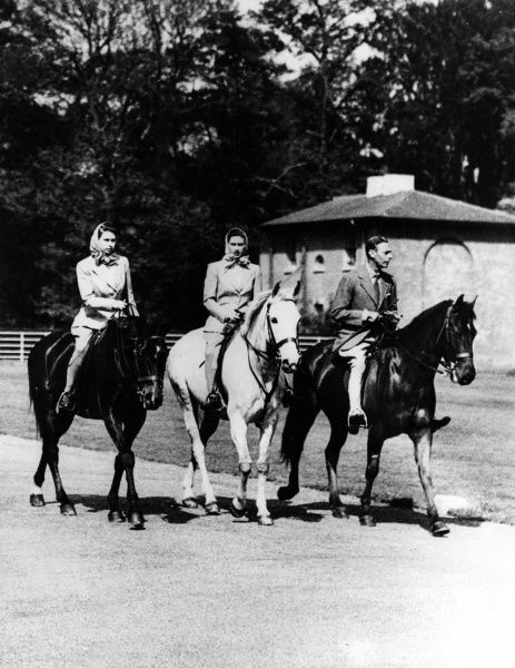 King George VI out riding with his daughters Princess Elizabeth and Princess Margaret in Windsor Great Park. Date: May 1947