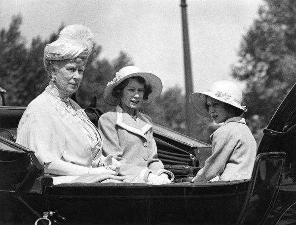 Queen Mary, Princess Elizabeth (later Queen Elizabeth II) and Princess Margaret in an open topped coach at the Trooping of the Colour on 9 June 1938. Date: 1938