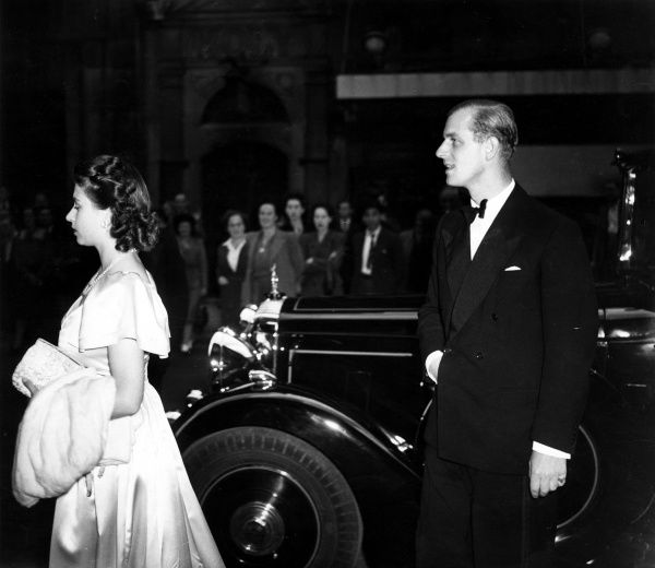 Royal Family visit Drury Lane Theatre to see the show Oklahoma. This day being the Queens (Elizabeth Bowes-Lyon) 47th birthday. The Princess Elizabeth and Lieutenant Philip Mountbatten leave their car to enter the theatre. Date: 4th August, 1947 Date