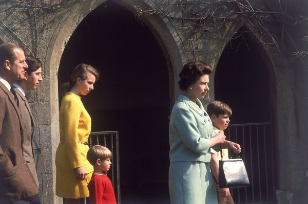 Queen Elizabeth II and her family at Windsor in 1968. Seen walking in profile from left, Prince Philip, Duke of Edinburgh, Princess Anne, Prince Edward, Earl of Wessex, the Queen and Prince Andrew, Duke of York. Date: 1968