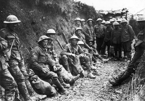 British troops - a party of the Royal Irish Rifles - rest in a communication trench on the first day of the Battle of the Somme