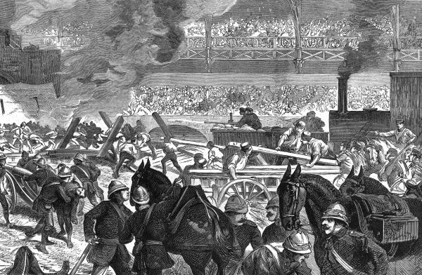 The Royal Military Tournament: armour-clad train attacking a fort. Date: 1887
