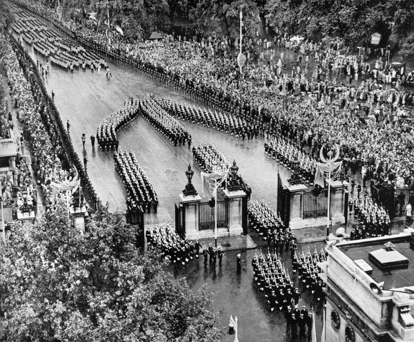 A contingent of the Royal Navy gives a superb display of marching skill as they reach Marble Arch. The three columns are seen at the moment of dividing.  1953