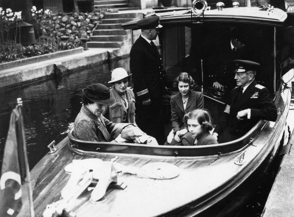 Princess Elizabeth (later Queen Elizabeth II) and Princess Margaret with their Scottish nurse, Marion Crawford (1909-1988), whom they nicknamed Crawfie. The are enjoying a boat trip on the river. Date: circa early 1940s