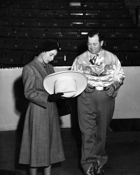 The Mayor of Calgary(Alberta), Mr Don Mackay, is here seen showing Princess Elizabeth a 'ten gallon' hat, when her Royal Highness and the Duke of Edinburgh(who was presented with, and wore, a 'ten gallon' hat), visited Calgary