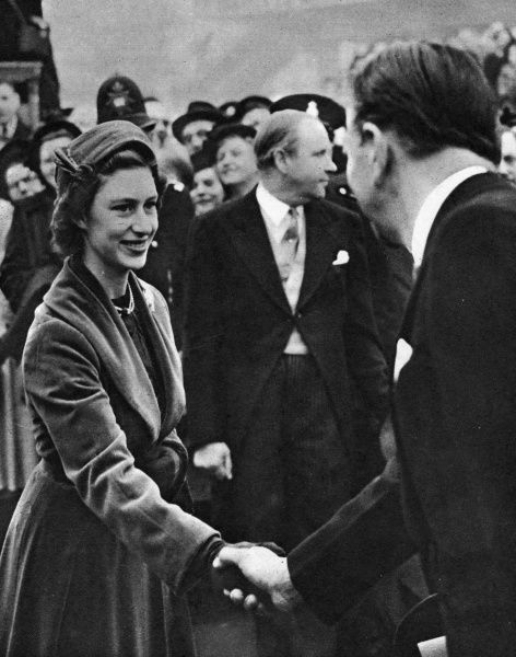 Scene at a royal visit to the Festival of Britain site on the South Bank, London. Here Princess Margaret is seen shaking hands with one of the exhibition officials. In the background is Gerald Barry, Director-General of the festival.  4 May 1951