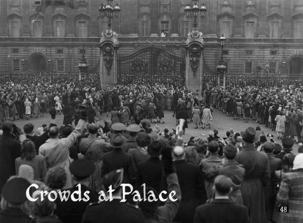 Crowds outside Buckingham Palace are rewarded by an appearance on the balcony of the newly married Princess Elizabeth (Queen Elizabeth II) and Prince Philip, Duke of Edinburgh following their wedding at Westminster Abbey on 20 November 1947. 1947