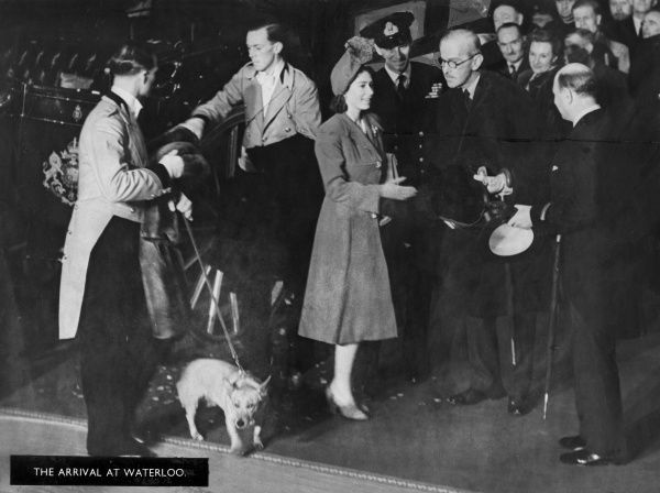 Following their wedding at Westminster Abbey on 20 November 1947, Princess Elizabeth and Prince Philip arrive at Waterloo Station, complete with corgi, to catch a train which will take them to Romsey in Hampshire for the first part of their honeymoon