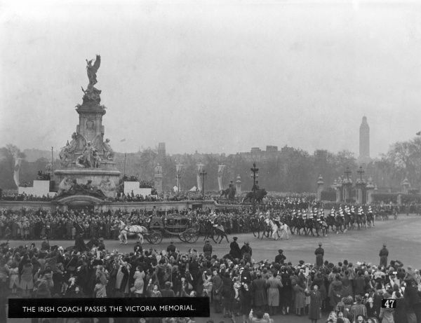 Scene outside Buckingham Palace by the Victoria Memorial showing coaches returning back from Westminster Abbey following the wedding of Princess Elizabeth and Lieutenant Philip Mountbatten on 20 November 1947
