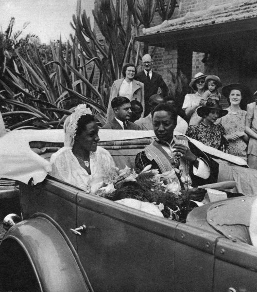 The Kabaka of Buganda, Edward Mutesa II, and his bride, Miss Damalie Kissononkole, driving back to the palace after the ceremony. Date: 1948