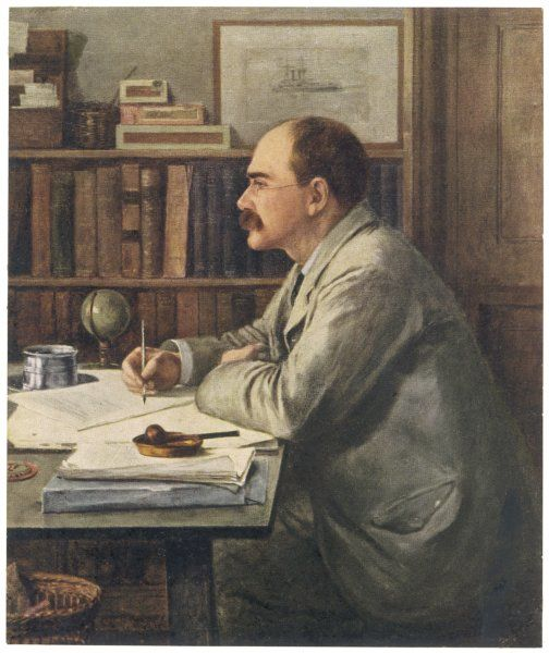 English writer, Rudyard Kipling (1865-1936) working at his desk