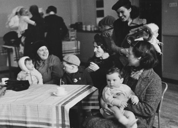Refugee mothers can buy a cup of tea from the Voluntary Welfare Workers in England during World War II