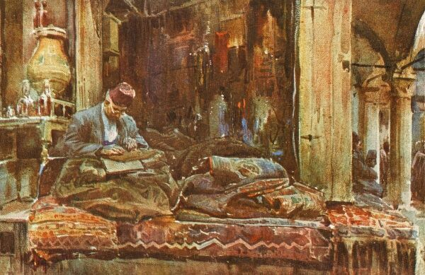 Rug shop in the Grand Bazaar, Constantinople, with the proprietor examining a rug