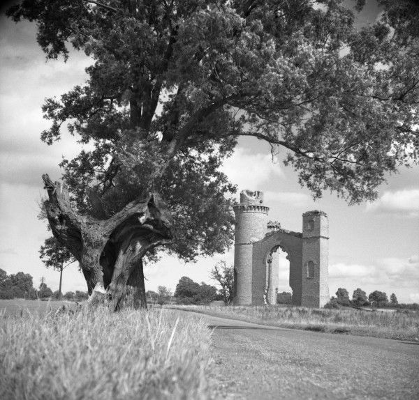 A Ruined building in the English countryside. Whether the remains of a castle, part of a manor house or just a Victorian folly - sadly we cannot tell. Photograph by Norman Synge Waller Budd