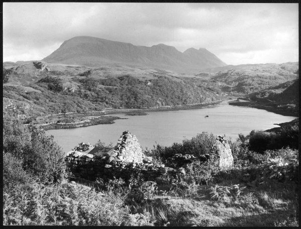 A view overlooking Loch Nedd, including a ruined croft and the Quinag Mountain, in Sutherlandshire, Scotland