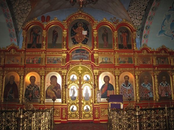 Russia, Astrakhan. The Maria Ascension cathedral, interior, showing painted icons on a beautifully-decorated screen. Date: 2010
