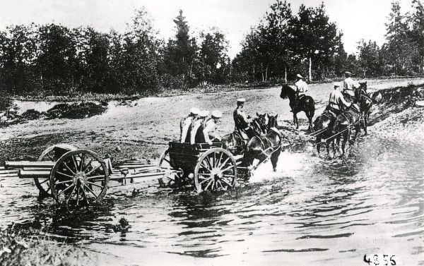 Russian artillery crossing a ford near St Petersburg during the First World War.  1914-1918
