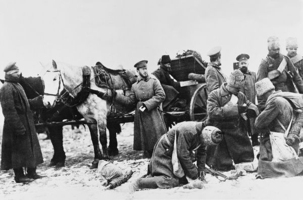 Russian troops on the Eastern Front replenish their ammunition supplies from a horse-drawn wagon