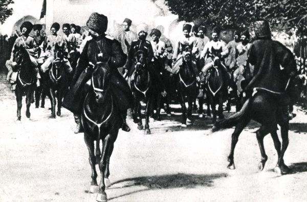 Russian troops under General Baratoff (centre, wearing a light-coloured hat) entering a Persian town on horseback during the First World War. Date: circa 1916