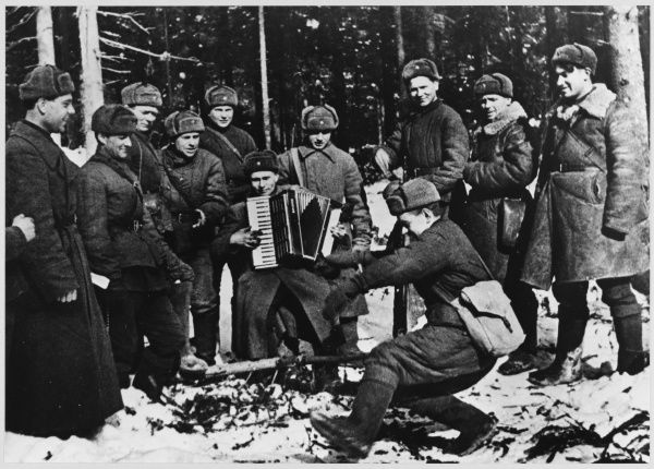 Soviet troops entertain themselves, they play the accordion and dance