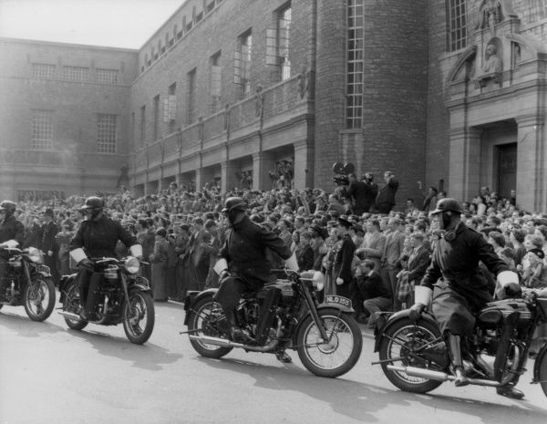 Crowd control police on motorbikes during a visit of Soviet leaders to Oxford, England. Date: April 1956