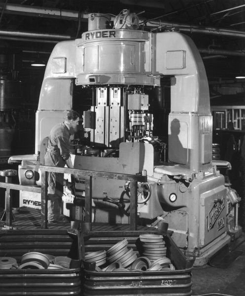 A Ryder disc brake pad machine in action in a car factory. Photograph by Heinz Zinram