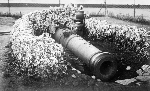 A sacred canon decorated with flowers as part of a fertility ritual, Java, Indonesia. Date: early 1930s