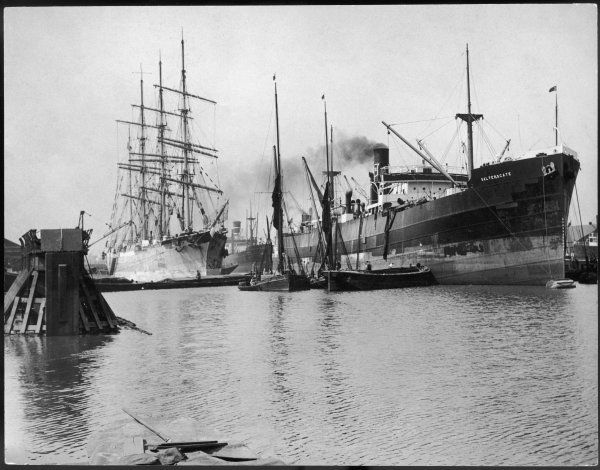 The 'Abraham Rydberg' in Millwall Docks, London. Built in 1879 in Sweden as a training ship for the Abraham Rydberg Foundation. Here alongside steamship 'Saltersgate&#39