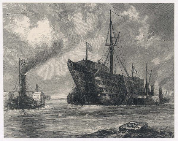 The old sailing ship towed to her last berth