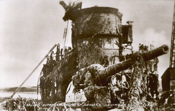 A scuttled German destroyer is salvaged at Scapa Flow