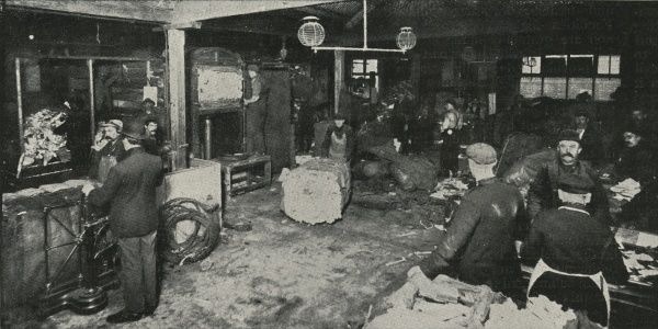 Men at work sorting waste paper in a Salvation Army Elevator. Elevators, which aimed to help the unskilled or unemployed, combined a factory space together with hostel accommodation for those working there