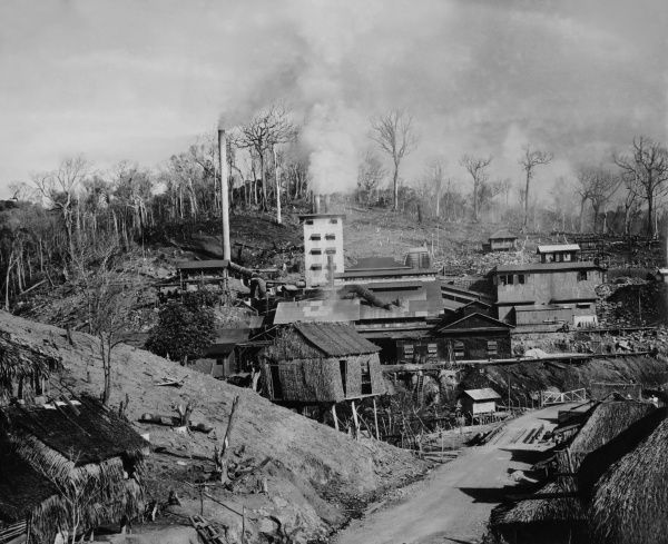 The only smelting plant at the San Mauricio Mine at the Marsman Company at Camarines Norte, Luzon, Philippines. The sulphur fumes created have destroyed plants for miles. Date: 1930s
