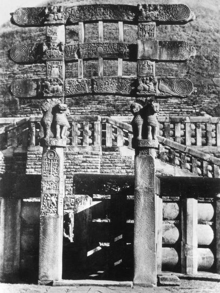 The Southern Gateway at Sanchi, India, where the Buddha is represented in a series of symbols, as was the tradition in early Buddhism. Date: 1930s