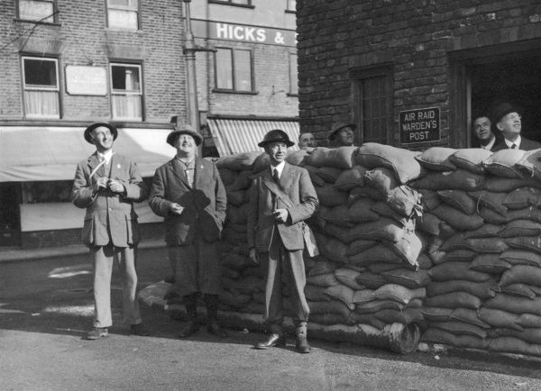 Town officials outside the the Guildhall of Sandwich, build in 1658, now with a 1939 barricade of sandbags around it