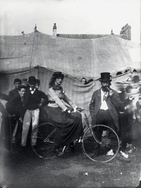 A 'lady' cyclist (probably a man in drag), one of the performers with Sanger's Circus during a visit to Haverfordwest, Pembrokeshire, Dyfed, South Wales