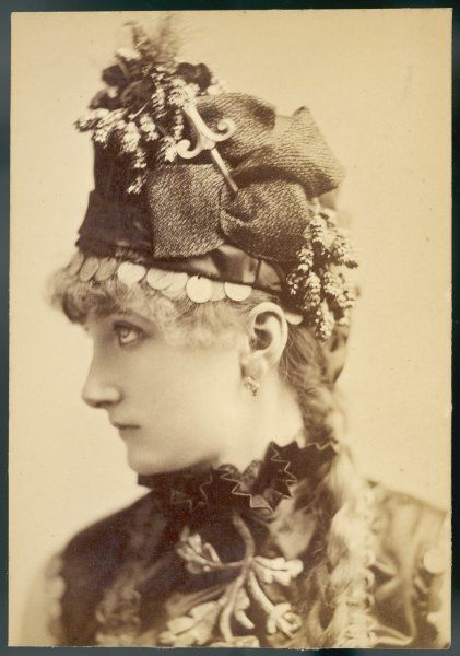 SARAH BERNHARDT (1845 - 1923) French actress in a decorative hat trimmed with coins