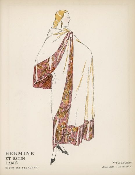 Sumptuous evening cloak or wrap in ermine fur bordered with satin lame in an ornate design