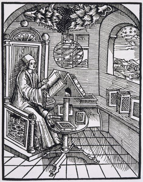 A scholar, with an interest in astronomy, reading in his study