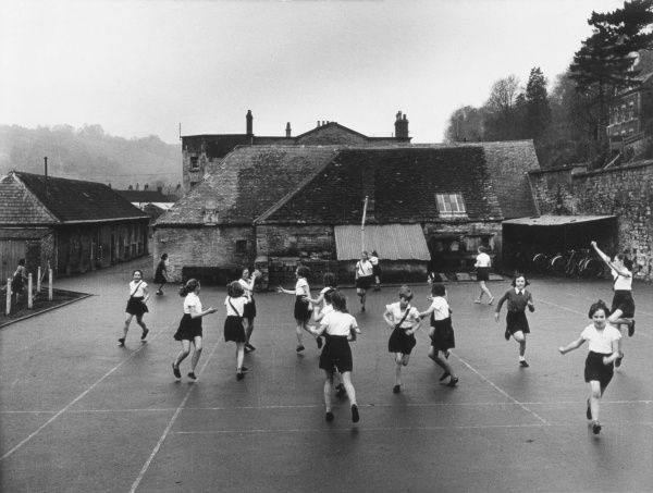 A netball game in progress at a school