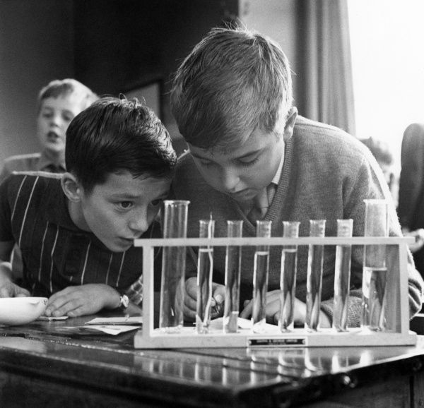 Two boys experimenting with test tubes at Northfield House Junior School, Leicester. Date: 1965